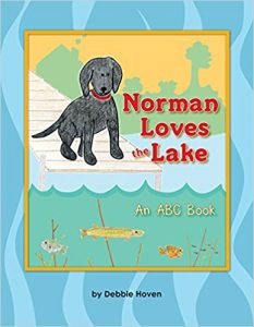Join Norman, a fun loving black lab, as he discovers how wonderful life is living lakeside.