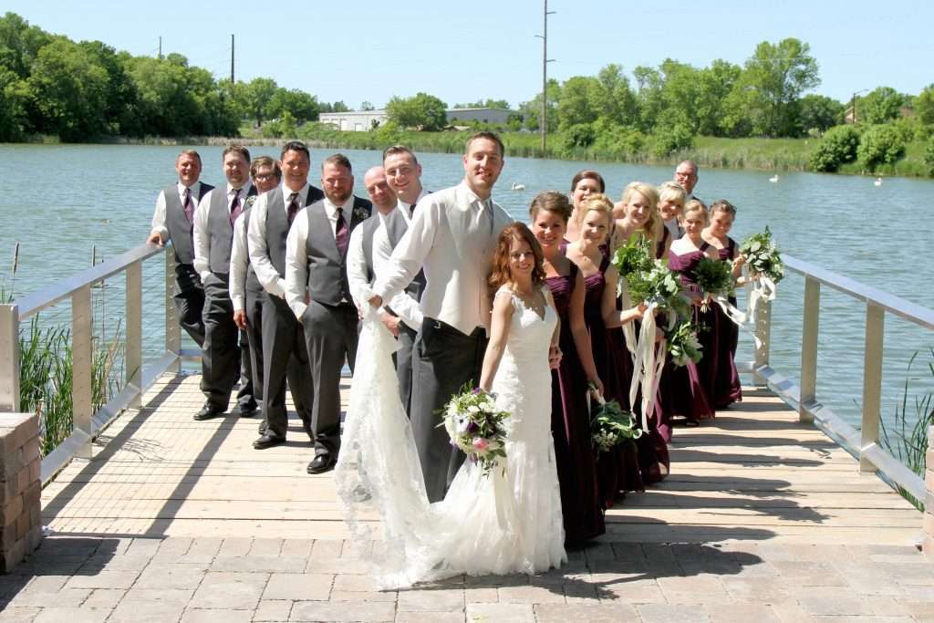 Wedding party on a dock by a lake