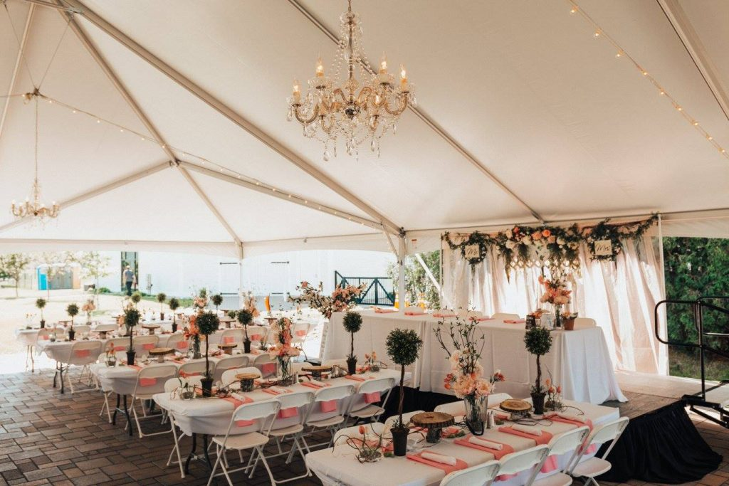 Ceremony space set up under event tent